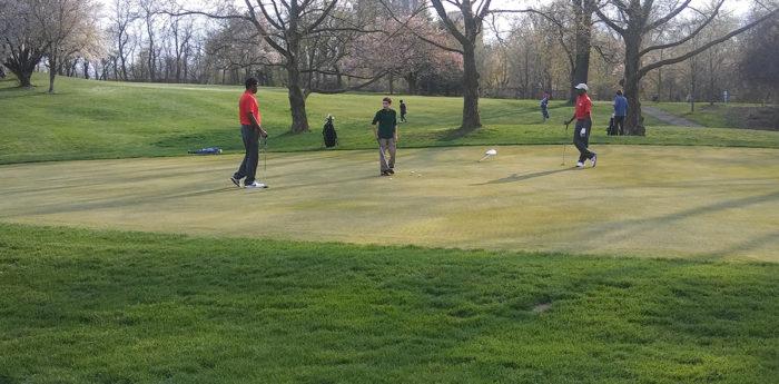golf team plays first match