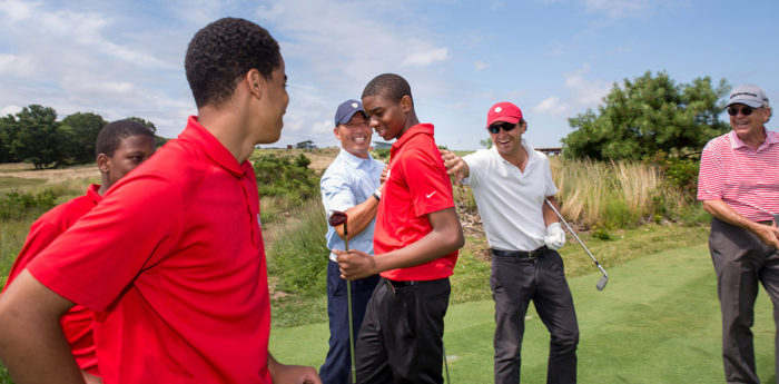 Tariq Washington, center, hit the shot of the day during our par-3 tournament at The Bridge last summer