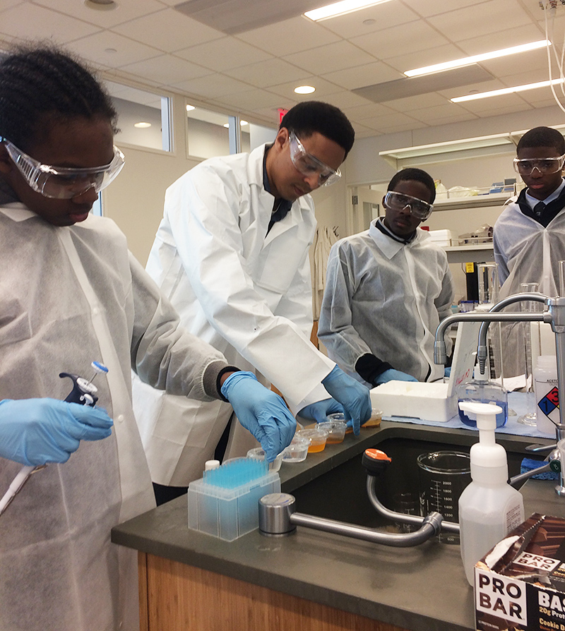 Triniim Jones, Dr. Jared Day, Kyle Barthelmy and Tariq Washington in the lab at CCNY