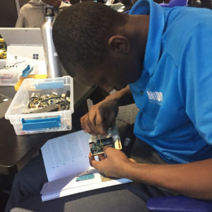 Yohance Whyte working on a circuit for sprinkler project