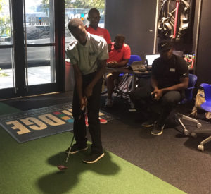 Josh Arthur putts in summer program competition
