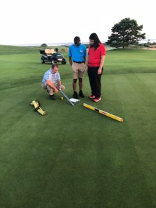 Yohance Whyte, center, and Alejandro Martinez with Course Superintendent Gregg Stanley