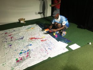 Elijah Opoku working on our Jackson Pollock-inspired group painting.