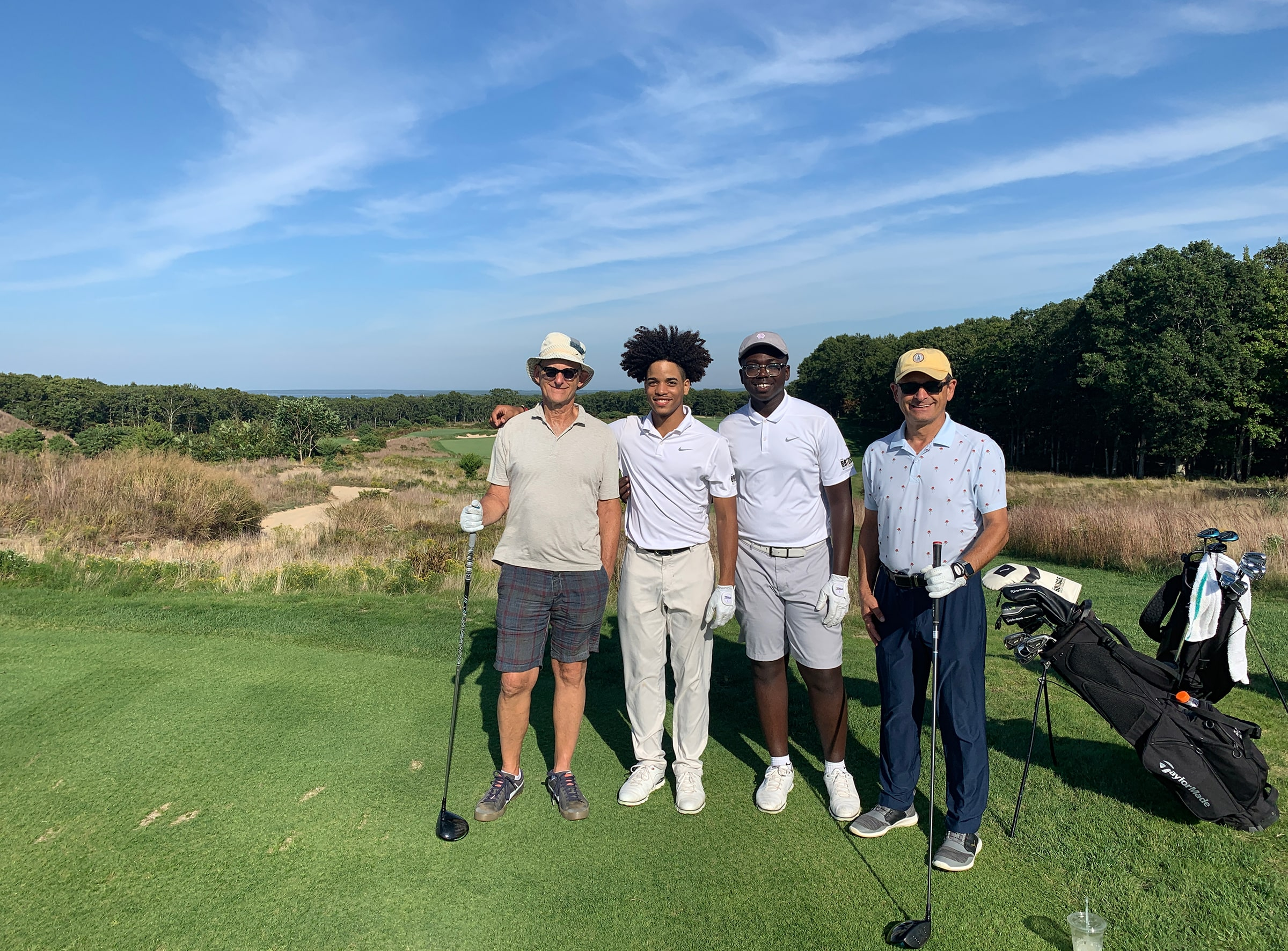 Bob Rubin, co-founder of The Bridge Golf Foundation, played with, from left, Juan Cortorreal, Zion Smith, and Mark Cohen.
