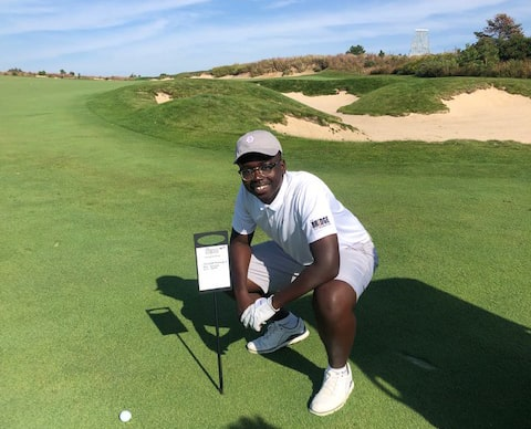 Zion Smith with long drive marker at The Bridge