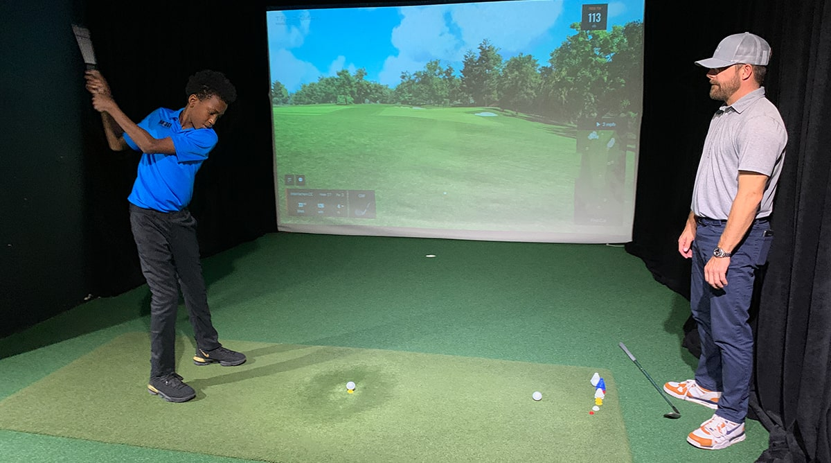 Horace Shelton with Tyler Lower at The Bridge Golf Learning Center in Harlem