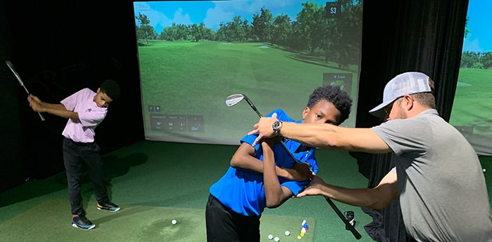 pro giving junior lessons at The Bridge Golf Learning Center