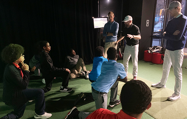 Tyler Lower at The Bridge Golf Learning Center with Foundation students